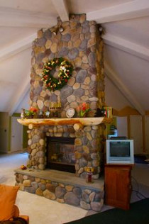 Two Sided Stone Fireplace with Log Mantle